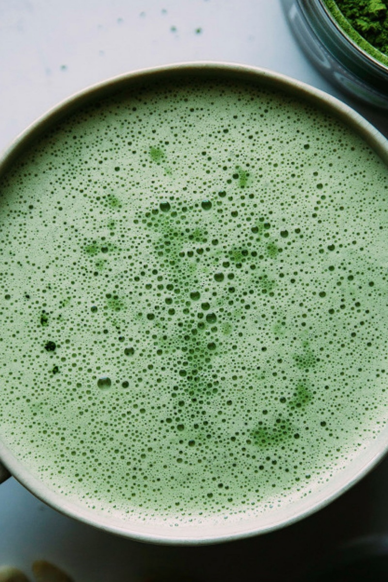 close up birds eye image of bubbly green matcha latte