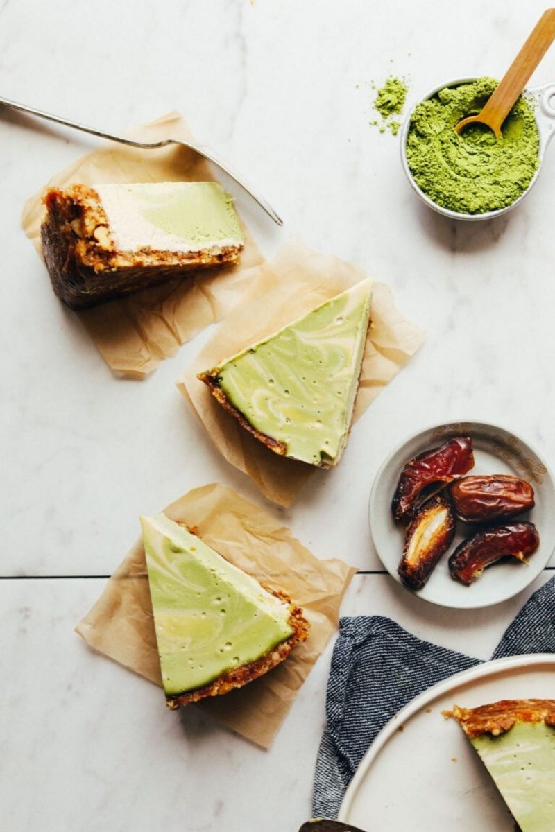 three slices of green cheesecake on parchment paper
