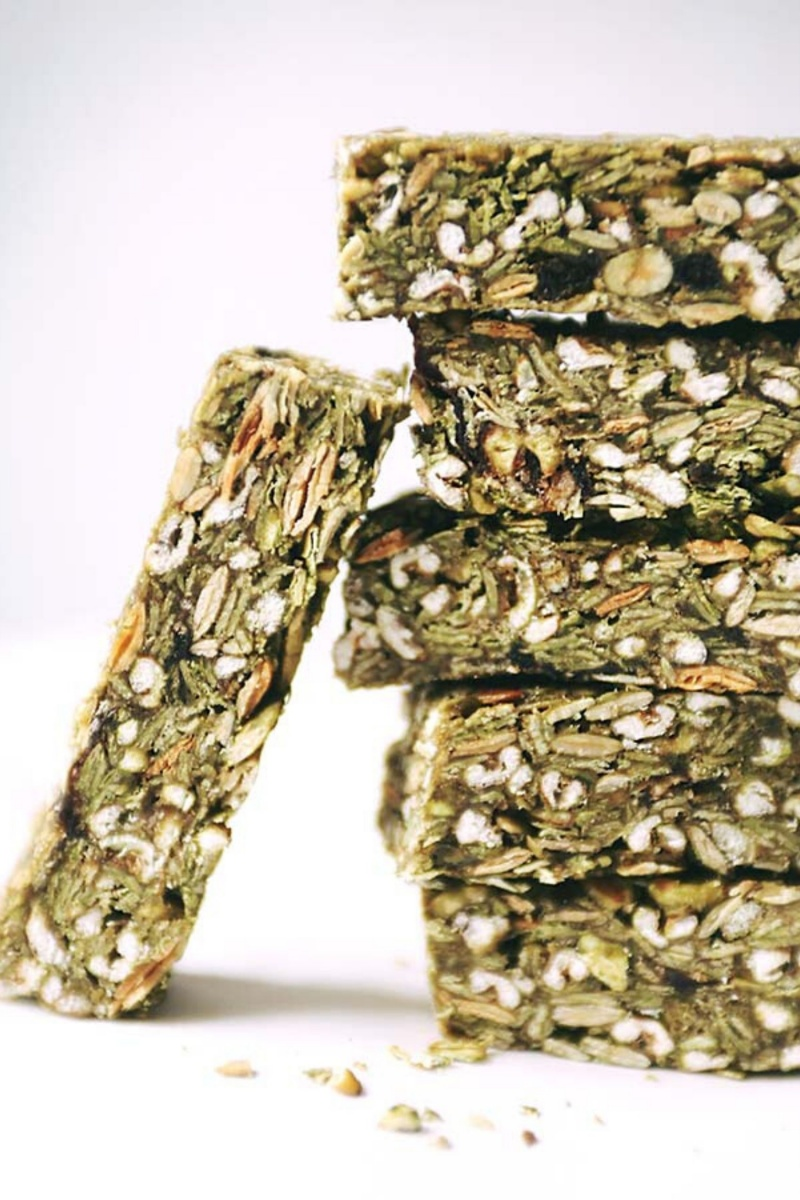 stack of five green matcha granola bars with one propped up on the side