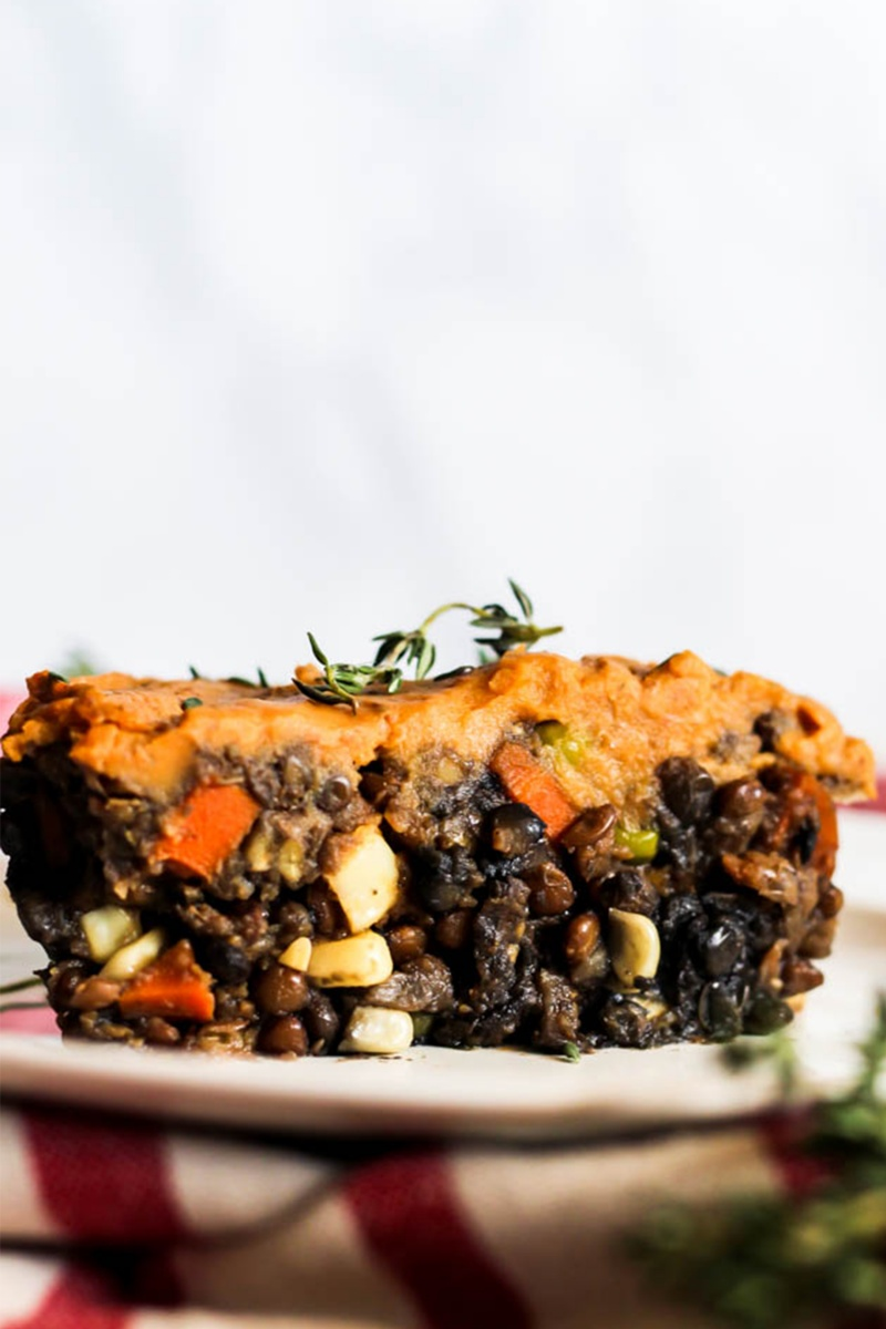 vegan pantry meal of black beans covered in orange sweet potatoes