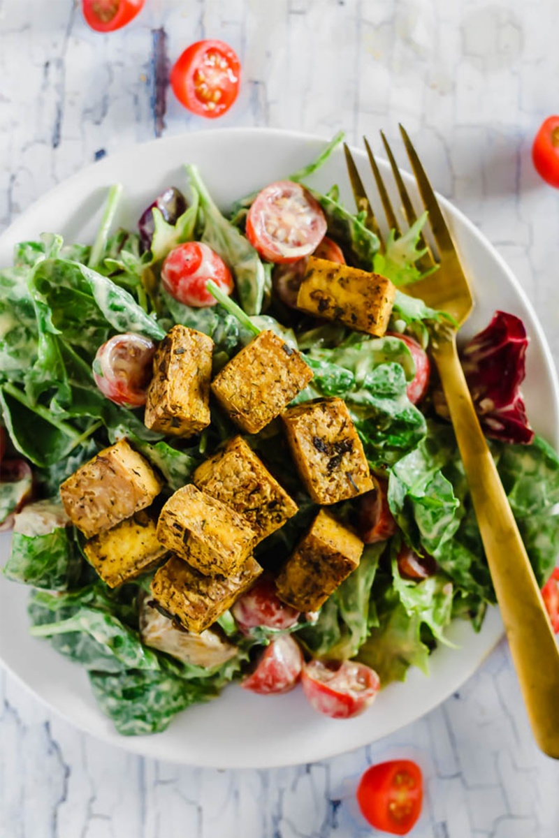 crispy tofu cubes on salad