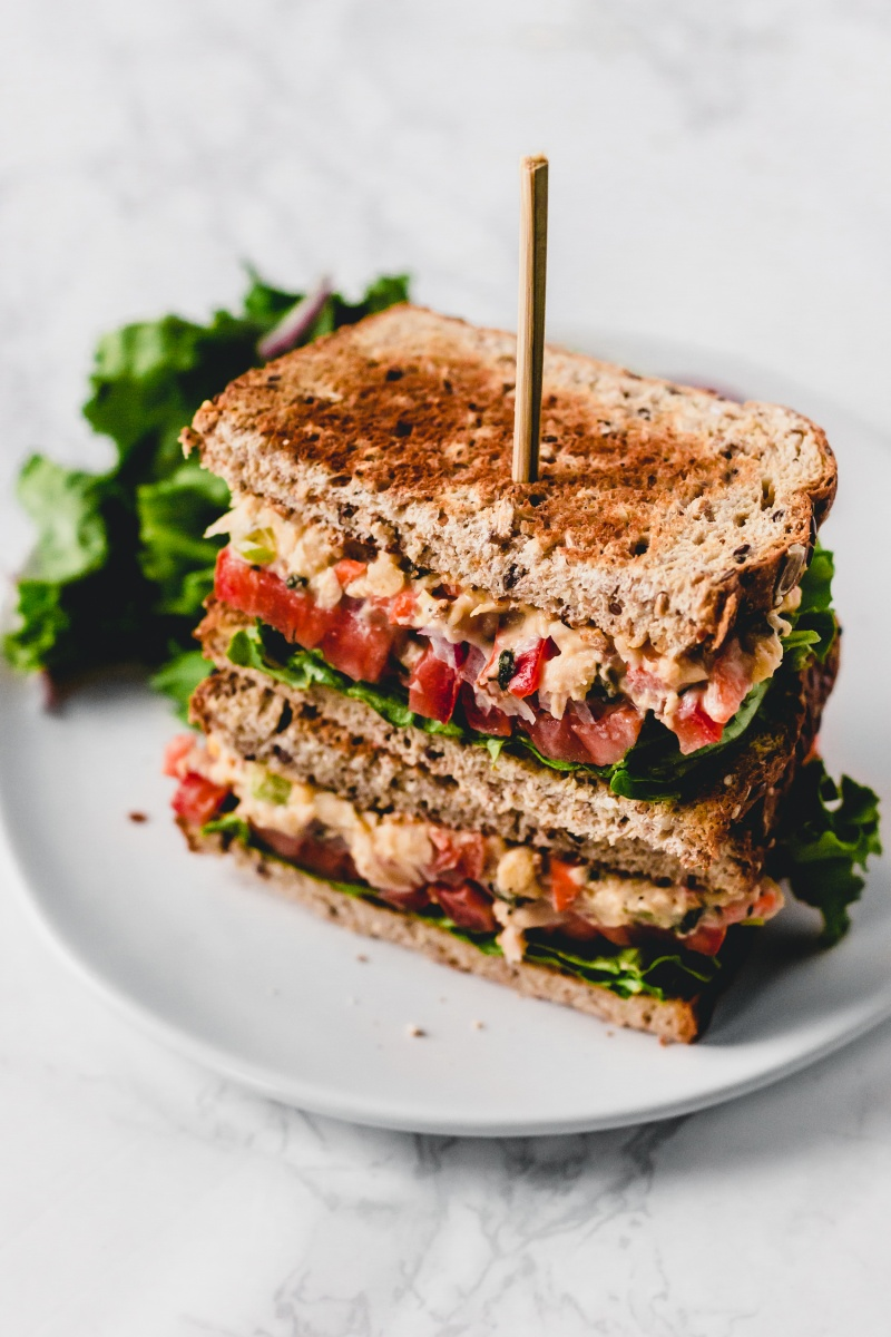 vegan tuna salad sandwich on white plate