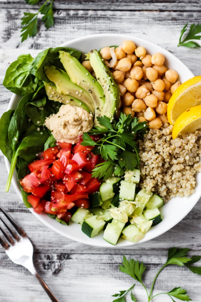 greek quinoa bowl overhead shot with chickpeas and avocado