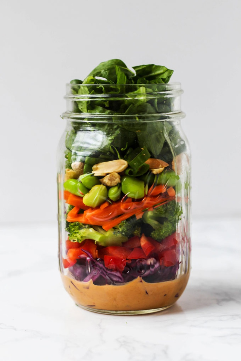 mason jar salad with layered vegetables
