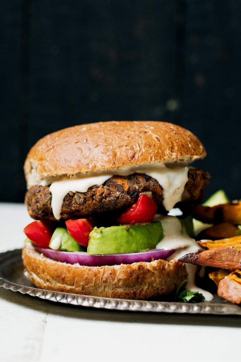 vegan black bean burger on bun with avocado