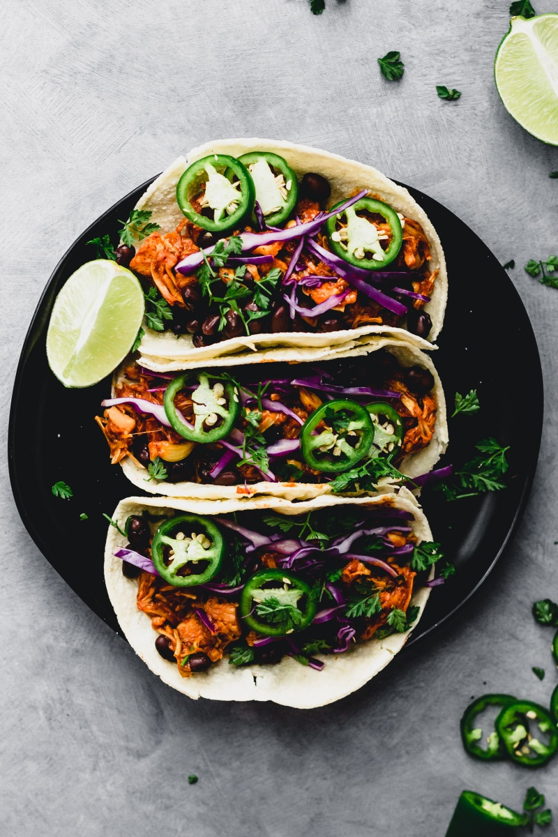 vegan bbq jackfruit tacos with cabbage and lime wedge