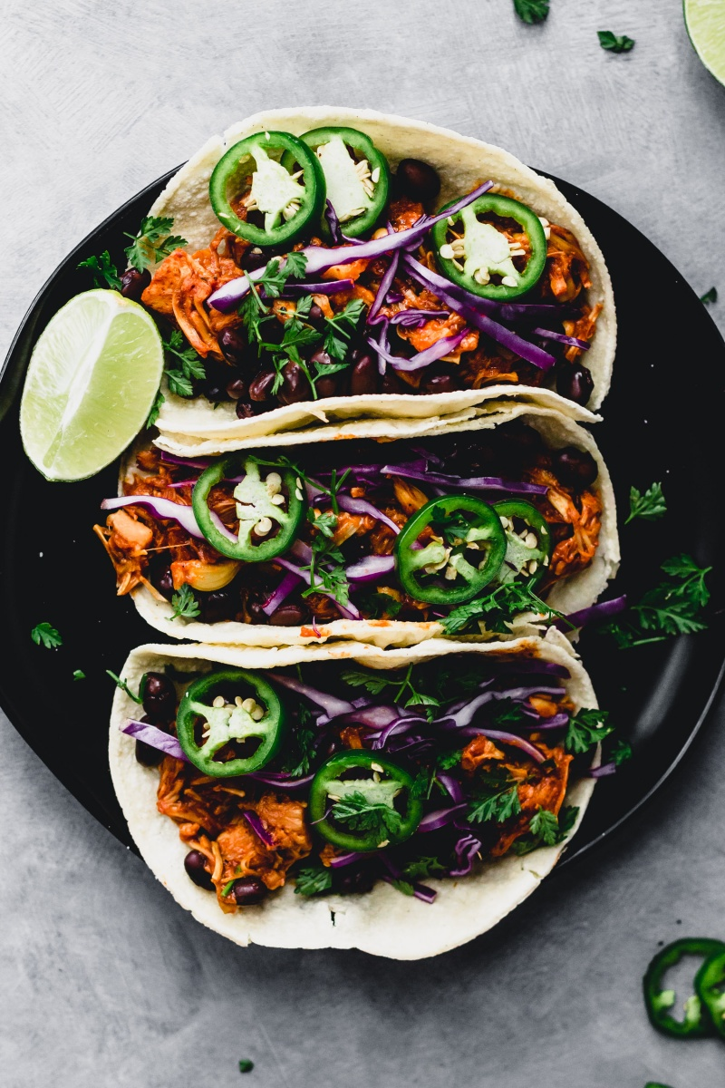black plate of three bbq jackfruit tacos