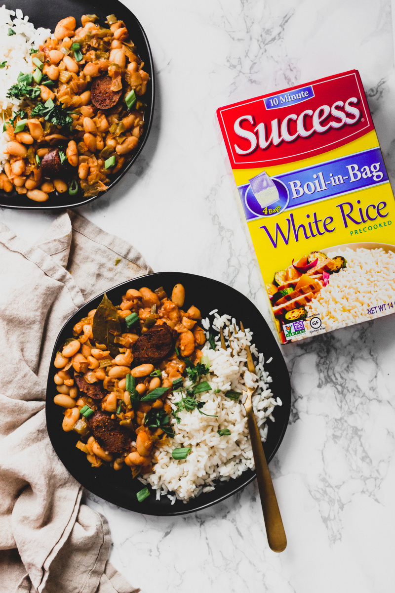 overhead shot of vegan white beans and rice next to box of success rice