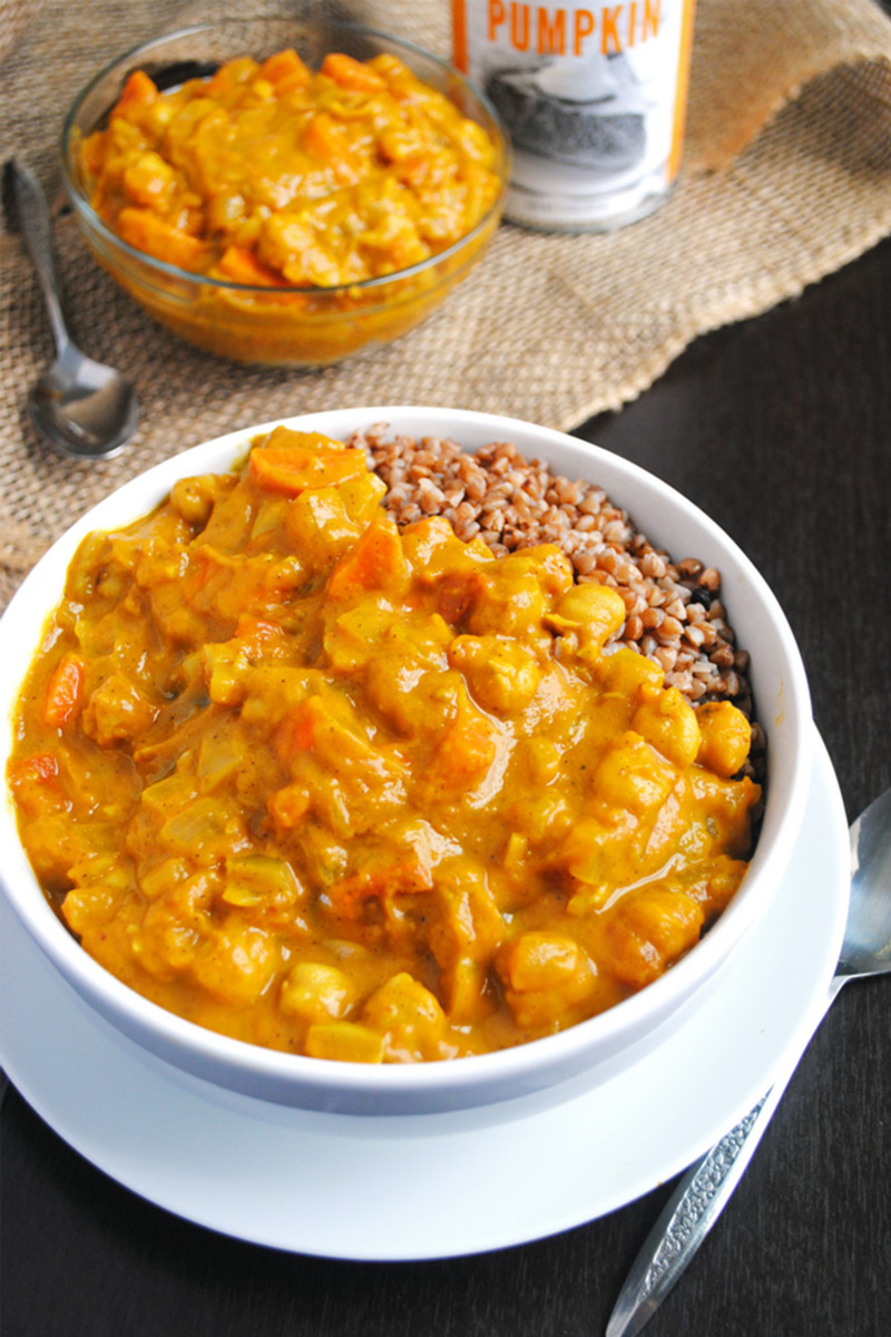 A bowl of chickpea and pumpkin coconut curry served with buckwheat groats