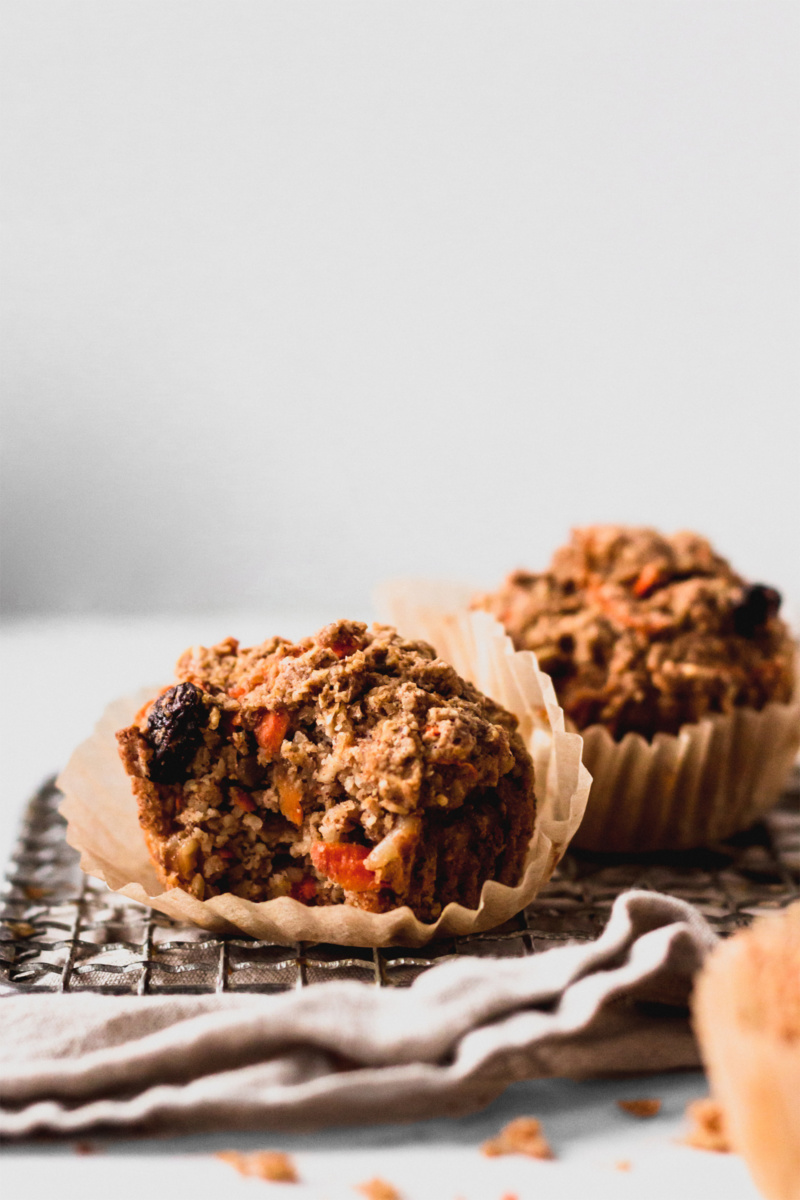 carrot cake muffins rest on a cooling rack