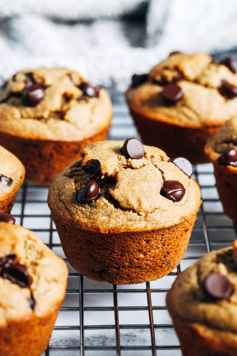 oatmeal banana chocolate chip muffins resting on a cooling rack