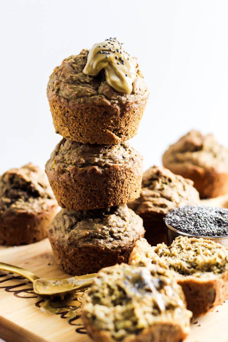almond butter chia muffins served on a wooden cutting board and topped with almond butter