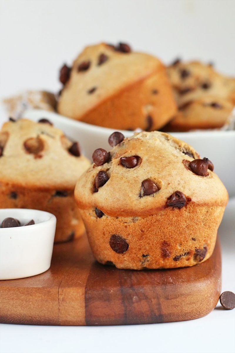 vegan chocolate chip muffins served on a wooden cutting board