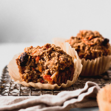 A close up shot of two vegan carrot cake muffins