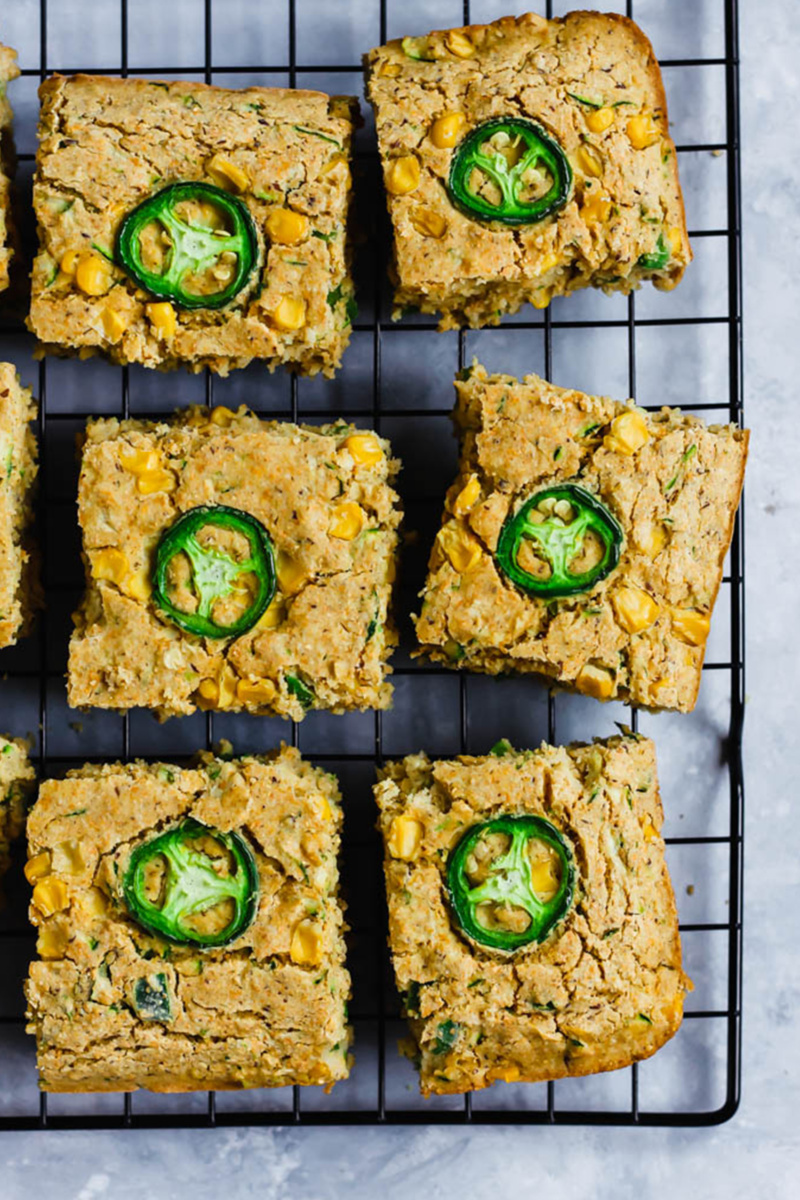 vegan zucchini cornbread topped with slices of jalapeno