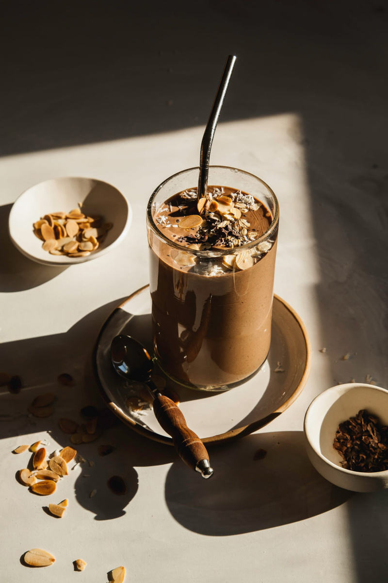 a chocolate smoothie topped with chopped almonds