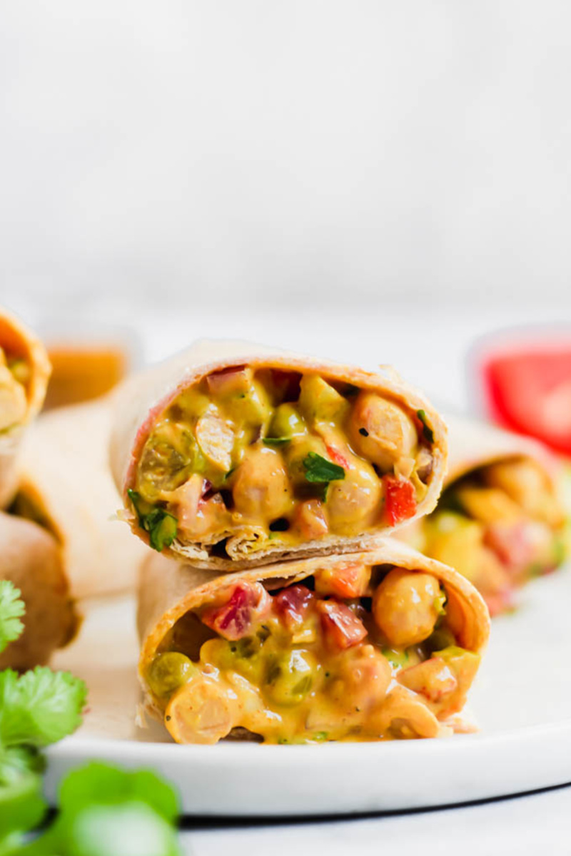a curried chickpea wrap cut in half
