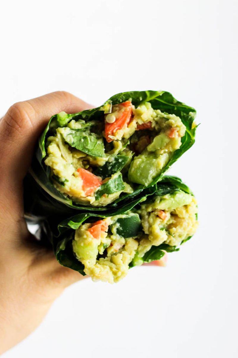 a collard wrap filled with avocado and veggies