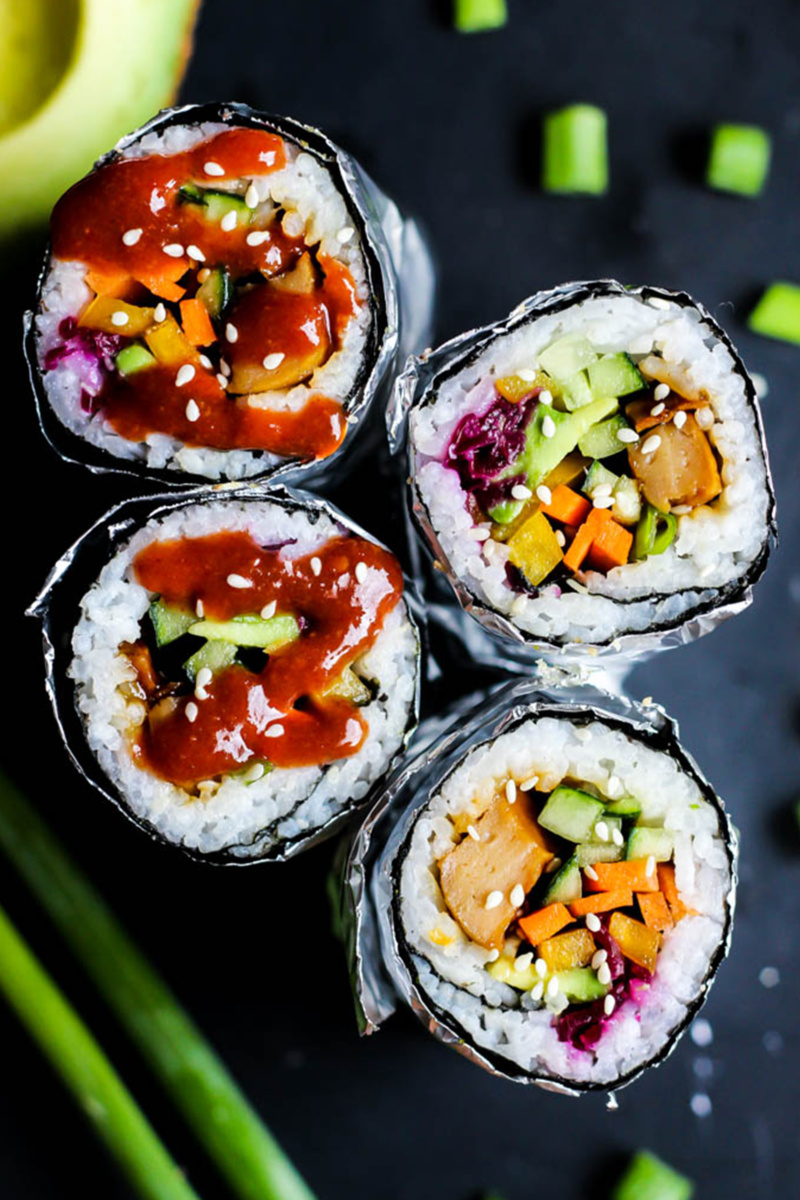 two vegan sushi burritos cut in half