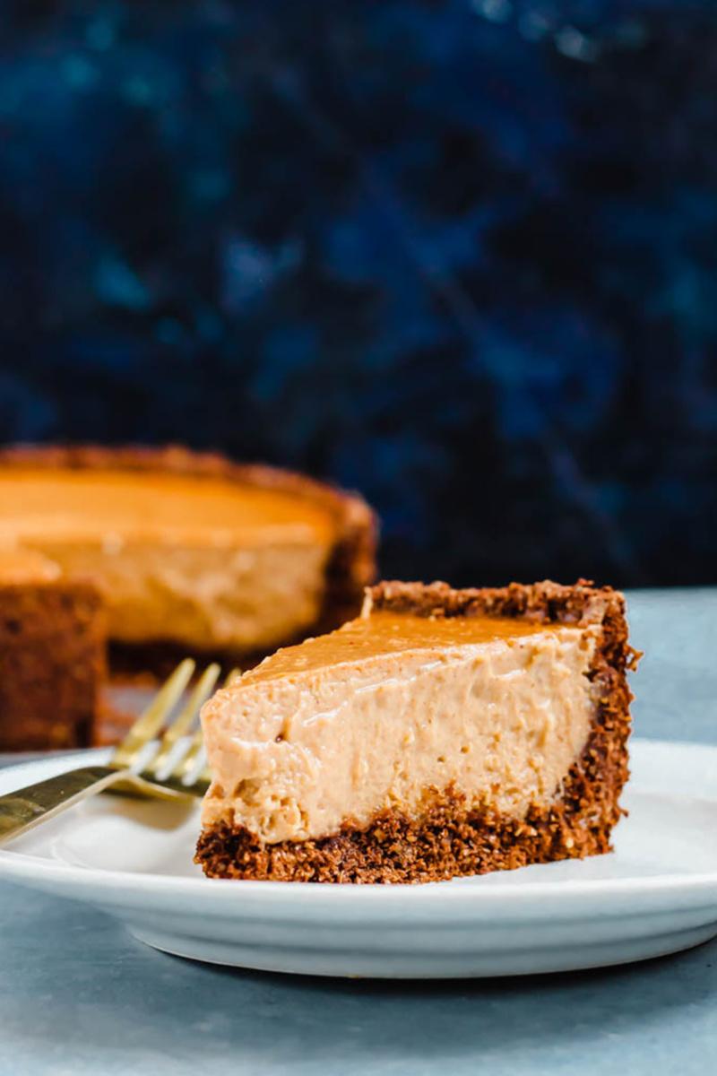 a plate of homemade vegan pumpkin cheesecake